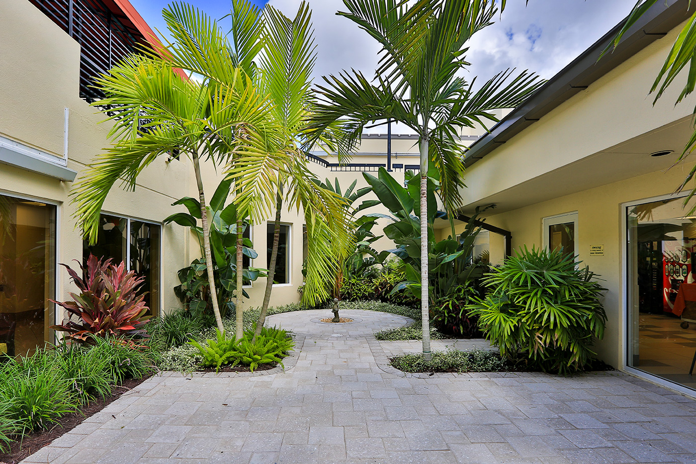 Morse Life: Outdoor Areas : West Palm Beach, FL  Renovation of outdoor areas which included the Walkway, Patio, and Courtyards. Work included:demolition, new landscaping, irrigation, brick pavers, textured walkways, stucco repairs, lighting,and painting